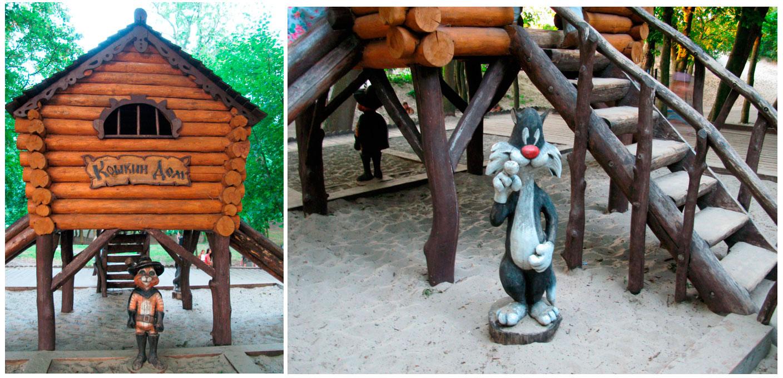 деревянные фигуры кошек в детском парке